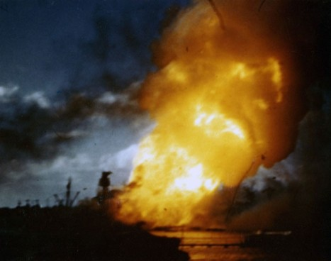 USS Arizona (BB-39) ablaze, immediately following the explosion of her forward magazines, Dec. 7, 1941. Frame clipped from a color motion picture taken from on board USS Solace (AH-5). Official U.S. Navy photograph, National Archives.