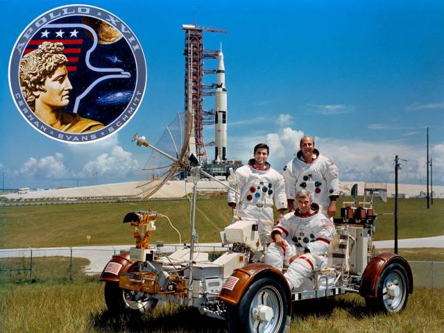 Crew of Apollo 17.   From left, astronauts Harrison Schmitt, Eugene Cernan and Ronald Evans are photographed with a lunar rover trainer and the mission's Saturn V rocket