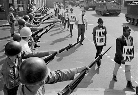"29 Mar 1968, Memphis, Tennessee, USA --- National Guard bayonets block Beale Street as African-American protesters march through downtown Memphis wearing placards reading ""I  A MAN.&quot. --- Image by © Bettmann/CORBIS"