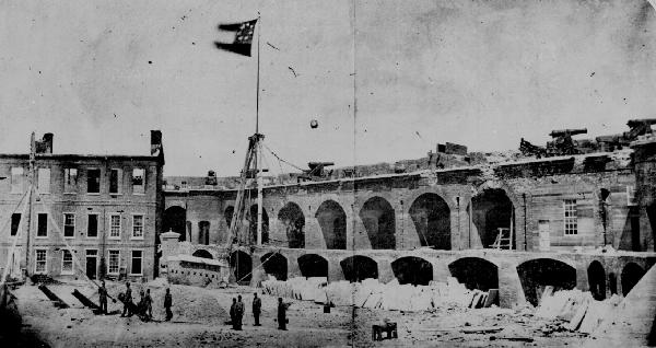 "Fort Sumter after its capture, showing damage from the Rebel bombardment of over 3000 shells and now flying the Rebel ""Stars and Bars"" - April 14, 1861."