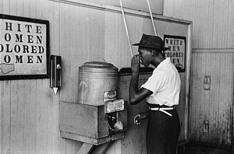 Blacks and whites drank from separate water fountains and coolers, as in this Oklahoma City streetcar station in 1939