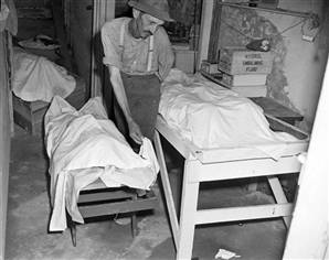 Monroe, Georgia coroner with two of the lynching victims