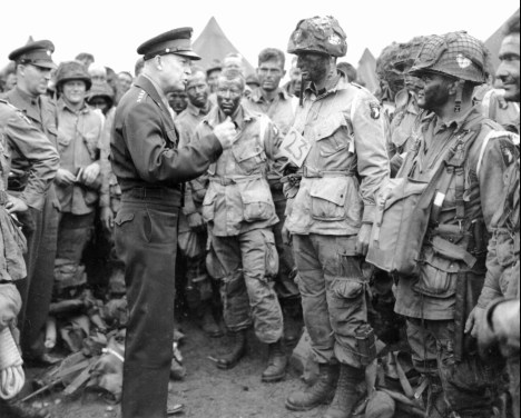 Gen. Dwight D. Eisenhower visits paratroopers in England on June 5, 1944, moments before the troops boarded transport planes bound for Normandy and the June 6 D-Day invasion. (AP Photo/File)
