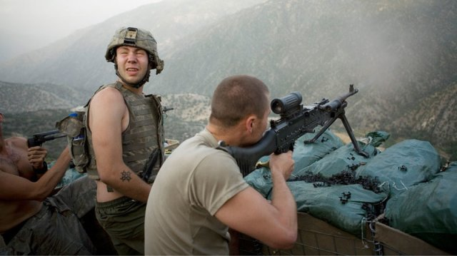 Firefight in 2008 in Korengal Valley in Afghanistan's Kunar Province/ Sebastian Junger and Tim Hetherington/Outpost Films