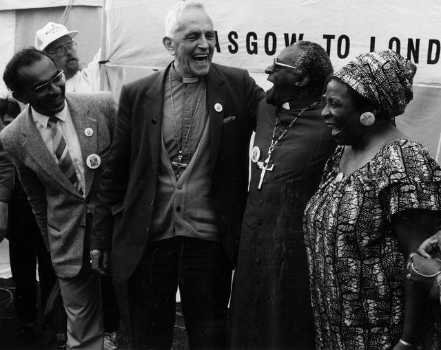 Abdul Minty, Father Trevor Huddleston, Archbishop Desmond Tutu and Adelaide Tambo at the Nelson Mandela Freedom March, England, July 1988.