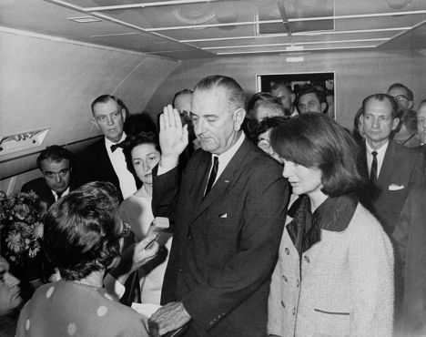 Johnson taking the oath of office aboard Air Force One, November 22, 1963