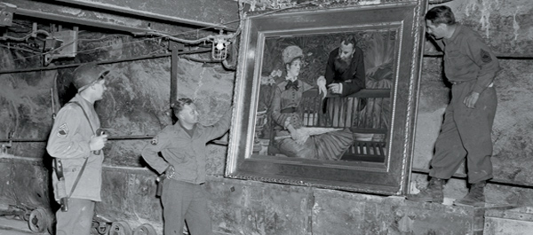 Allied troops in 1945 with art looted by the Nazis and stored in a salt mine near the German village of Merkers. (Photo: National Archives)