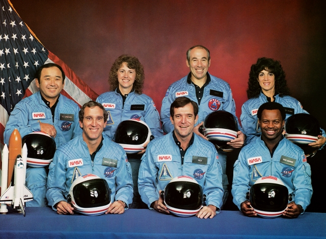 The shuttle Challenger flight STS-51L crew members who died January 28, 1986. In the back row, from left, mission specialist Ellison S. Onizuka, Teacher in Space Participant Sharon Christa McAuliffe, Payload Specialist Greg Jarvis and Mission specialist Judy Resnik. In the front row, from left, Pilot Mike Smith, Commander Dick Scobee, and Mission specialist Ron McNair.