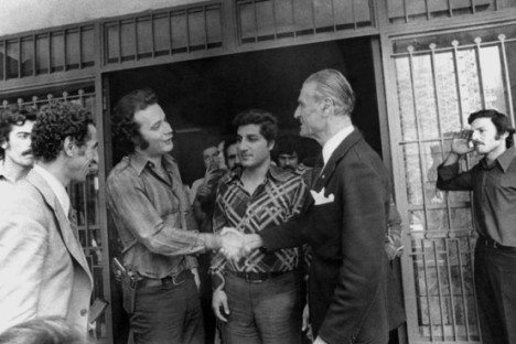 Ali Hassan Salameh (left) shaking hands with Pierre Gemayel, the founder of the Lebanese Phalangist party. Gemayel's son Bashir is between them. As-Safir newspaper, Beirut
