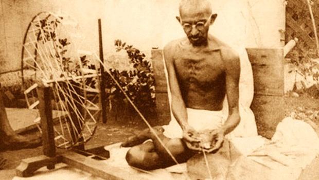 Mahatma Gandhi spinning yarn, in late 1920