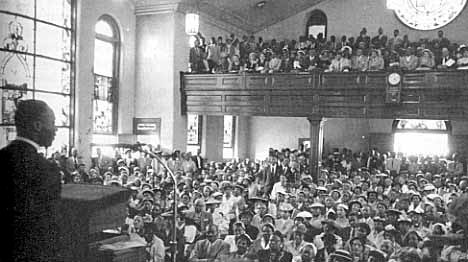 Martin Luther King at First Montgomery Improvement Association Meeting to Organize the Montgomery Bus Boycott Holt Street Baptist Church, Montgomery Alabama 12/5/1955.