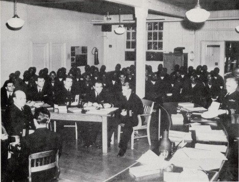 The Navy defense team sits in front of the fifty accused stevedores during the trial on Treasure Island in 1944.