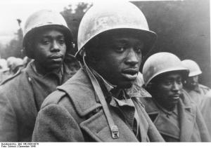 The hypocrisy of segregation:  black men fighting for freedom abroad (Battle of the Bulge, 1944)