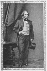 Full-length black-and-white portrait of Henry Wadworth Longfellow in 1860