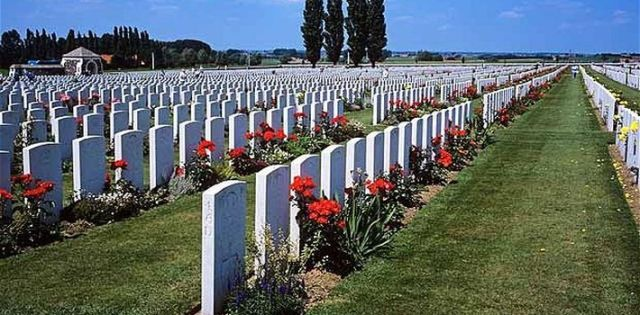 After WWI:  Cemetary in Belgium where the poppies grow between the crosses, row on row