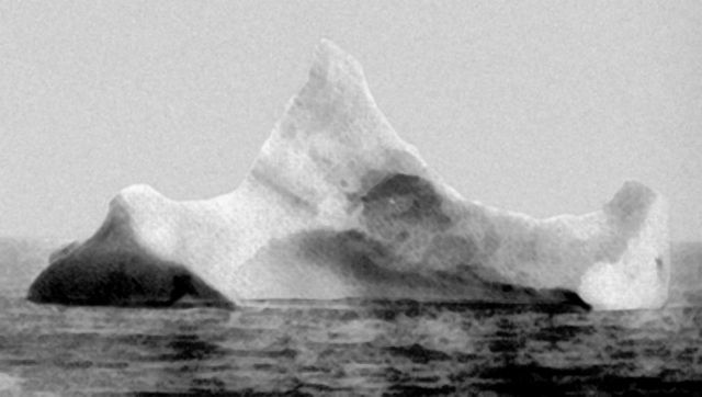 The iceberg thought to have been hit by Titanic, photographed by the chief steward of the liner Prinz Adalbert on the morning of 15 April 1912. The iceberg was reported to have a streak of red paint from a ship's hull along its waterline on one side.