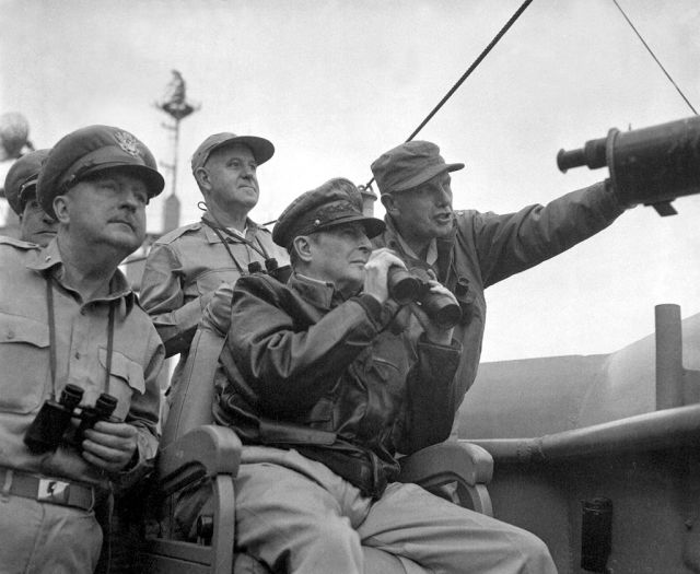 MacArthur observes the naval shelling of Inchon from USS Mount McKinley, 15 September 1950 with Brigadier General Courtney Whitney (left) and Major General Edward M. Almond (right).