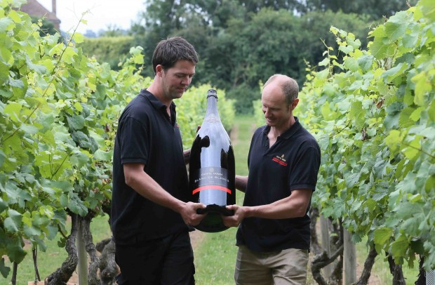 Winemakers carry Britain's biggest ever bottle of English sparkling wine, produced by the Chapel Down Winery in Kent. The bottle is a unique, 15-litre Nebuchadnezzar of Chapel Down's gold medal-winning Blanc de Blancs 2007 sparkling wine. Photo credit: Hugo Philpott/PA Wire
